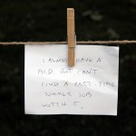"Note pinned to clothes line that reads ""I almost have a Ph.D. but can't find a part-time summer job. Worth it."""