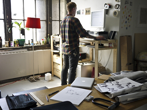 Photo of man working at standing desk.