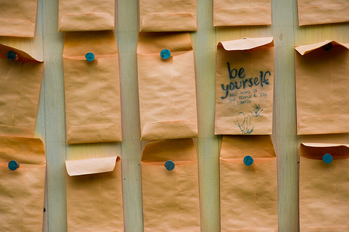 """Photo of notes on pegboard with message """"Be Yourself"""""""