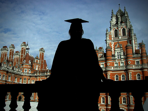 Silhouette of person in grad gown and hat