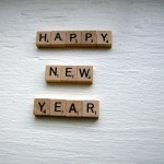 """Photo of scrabble tiles spelling out """"Happy New Year"""""""