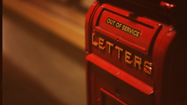 Photo of letter box with out of service sign