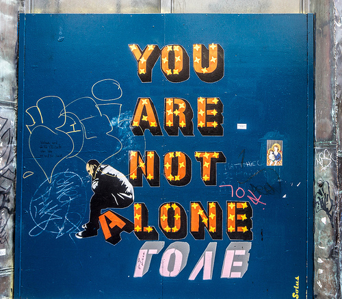 "Photo of sign that reads ""you are not alone"""